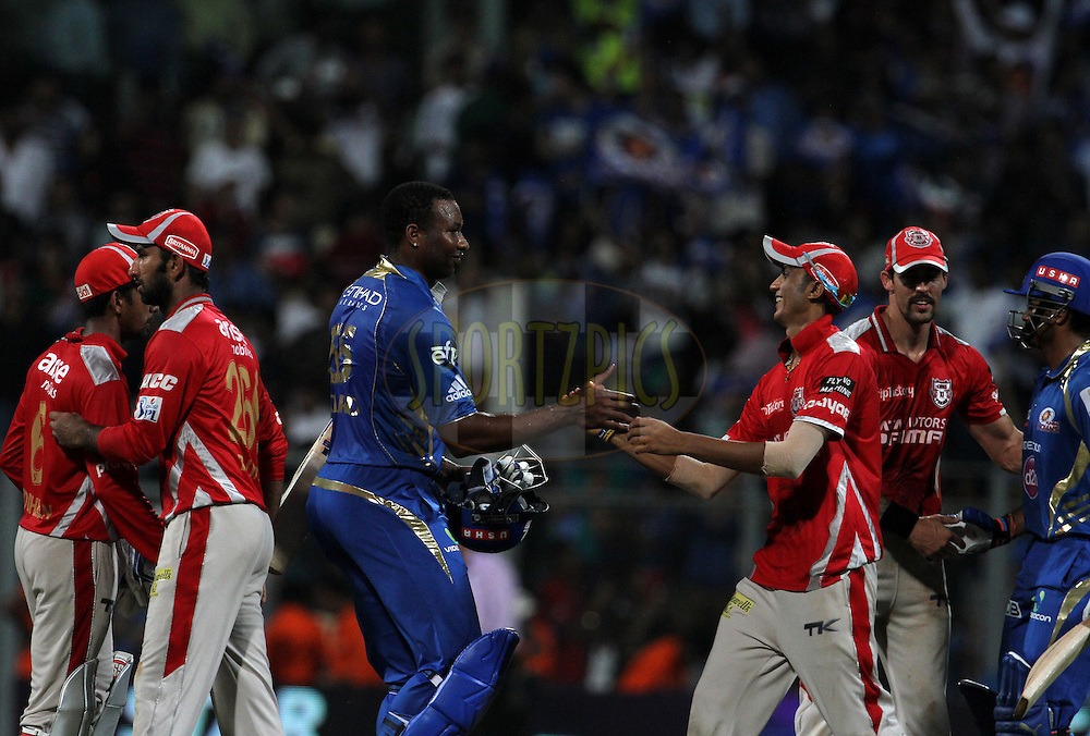 Kieron Pollard of the Mumbai Indians shake hands after winning against the Kings X1 Punjab during match 22 of the Pepsi Indian Premier League Season 2014 between the Mumbai Indians and the Kings XI Punjab held at the Wankhede Cricket Stadium, Mumbai, India on the 3rd May  2014<br /> <br /> Photo by Vipin Pawar / IPL / SPORTZPICS<br /> <br /> <br /> <br /> Image use subject to terms and conditions which can be found here:  http://sportzpics.photoshelter.com/gallery/Pepsi-IPL-Image-terms-and-conditions/G00004VW1IVJ.gB0/C0000TScjhBM6ikg
