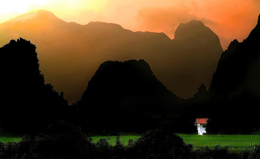A farm at sunset in Vang Viang, Laos