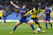 Sunderland defender (on loan from Bristol City) Bailey Wright (26) battles for possession  with Oxford United forward Dan Agyei (23) during the EFL Sky Bet League 1 match between Oxford United and Sunderland at the Kassam Stadium, Oxford, England on 15 February 2020.