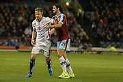 Burnley midfielder George Boyd gets hold of Milton Keynes Dons forward Dean Bowditch during the Sky Bet Championship match between Burnley and Milton Keynes Dons at Turf Moor, Burnley, England on 15 September 2015. Photo by Simon Davies.