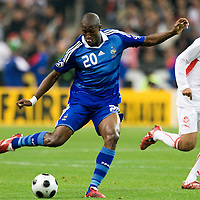 14 October 2008: French defender Rod Fanni #20 kicks the ball as #14 Wissem Ben Yahia watchs during the friendly football match won 3-1 by France over Tunisia on October 14, 2008, at the Stade de France in Saint-Denis, near Paris, France.