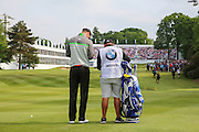 Chris Wood with caddie on the 18th fairway approaching the green during the BMW PGA Championship at Wentworth Club, Virginia Water, United Kingdom on 29 May 2016. Photo by Phil Duncan.