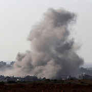 Smoke rises after an explosion in Gaza, August 2, 2014. Some Israeli ground forces withdrew from the Gaza Strip on Saturday, two Israeli television stations reported, after the military said it was close to achieving its main war goal of destroying Hamas cross-border tunnels. Asked about the reports, an Israeli military spokesman said she could not comment on troop deployments. Shelling exchanges continued, pushing the Gaza death toll given by Palestinian officials up to 1,669, but in some areas witnesses reported Israeli tanks pulling back toward the border. Israel said Palestinians launched 74 rockets across the border, most of which fell harmlessly wide while seven were shot down by its Iron Dome interceptor, including over Tel Aviv.  REUTERS/Siegfried Modola   (ISRAEL - Tags: POLITICS CONFLICT TPX IMAGES OF THE DAY) - GM1EA83069R01