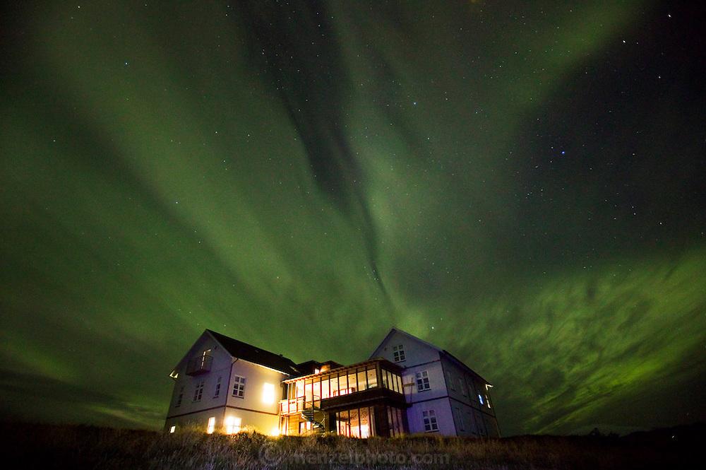 Northern lights and stars over the  Budir Hotel, Budir (Snaefellsnes) Iceland.