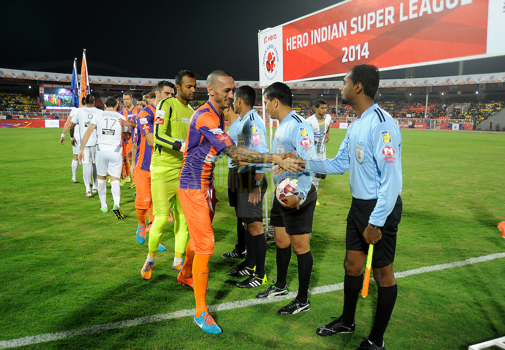 FC Pune City players shakes hand with the referees after the national anthem before the start of match 44 of the Hero Indian Super League between FC Pune City and Atletico de Kolkata FC held at the Shree Shiv Chhatrapati Sports Complex Stadium, Pune, India on the 29th November 2014.<br /> <br /> Photo by:  Pal Pillai/ ISL/ SPORTZPICS