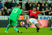Marcus Rashford (#10) of Manchester United stretches to reach a through pass but is beaten to the ball by Martin Dubravka (#12) of Newcastle United during the Premier League match between Newcastle United and Manchester United at St. James's Park, Newcastle, England on 2 January 2019.