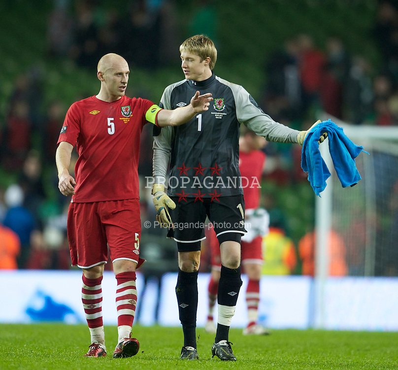 DUBLIN, IRELAND - Tuesday, February 8, 2011: Wales' James Collins and goalkeeper Wayne Hennessey look dejected after losing 3-0 to the Republic of Ireland during the opening Carling Nations Cup match at the Aviva Stadium (Lansdowne Road). (Photo by David Rawcliffe/Propaganda)