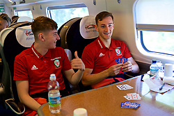 RUNCORN, ENGLAND - Tuesday, May 22, 2018: Wales' David Brooks and Tom Lockyer  travel by train as the squad heads to Heathrow for a flight to Los Angeles ahead of the international friendly match against Mexico. (Pic by David Rawcliffe/Propaganda)