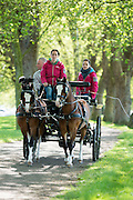 © Licensed to London News Pictures. 14/05/2014. Windsor, UK People exercise their horses in the sunny weather along the River Thames. The opening day of The Royal Windsor Horse Show, set in the grounds of Windsor Castle. Established in 1943. Photo credit : Stephen Simpson/LNP