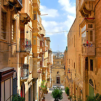 Couple Eating on St. Lucia Street in Valletta, Malta<br />