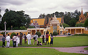 A wedding party having their photos taken in front of the Royal Palace of Cambodia, in Phnom Penh.