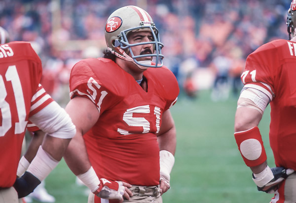 SAN FRANCISCO - JANUARY 6:  Randy Cross #61 of the San Francisco 49ers waits in the huddle during the NFC Championship game against the Chicago Bears played on January 6, 1985 at Candlestick Park in San Francisco, California. (Photo by David Madison/Getty Images) *** Local Caption *** Randy Cross