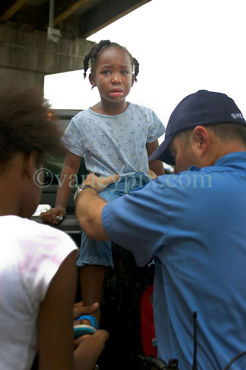 29th August, 2005. Hurricane Katrina hits New Orleans, Louisiana. Scared and relieved, 4yr old Anfernya Figueroa is rescued from the lower 9th ward after it disappeared under water.