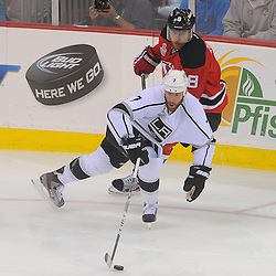June 2, 2012: Los Angeles Kings defenseman Rob Scuderi (7) controls the puck away from New Jersey Devils right wing Dainius Zubrus (8) during first period action in game 2 of the NHL Stanley Cup Final between the New Jersey Devils and the Los Angeles Kings at the Prudential Center in Newark, N.J.