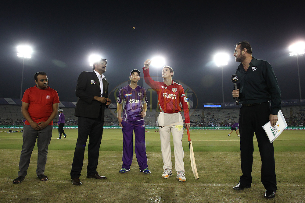 Match Referee Javagal Srinath looks on as Hobart Hurricanes captain Tim Paine calls and Kings XI Punjab captain George Bailey tosses the coin during match 2 of the Oppo Champions League Twenty20 between the Kings XI Punjab and the Hobart Hurricanes held at the Punjab Cricket Association Stadium, Mohali, India on the 18th September 2014<br /> <br /> Photo by:  Shaun Roy / Sportzpics/ CLT20<br /> <br /> <br /> Image use is subject to the terms and conditions as laid out by the BCCI/ CLT20.  The terms and conditions can be downloaded here:<br /> <br /> http://sportzpics.photoshelter.com/gallery/CLT20-Image-Terms-and-Conditions-2014/G0000IfNJn535VPU/C0000QhhKadWcjYs