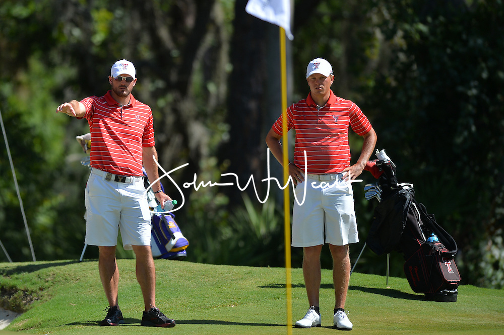 Hannes Roenneblad with assistant coach Jeremy Alcorn during  the second round of the NCAA Golf Championships at the Concession Golf Club in Bradenton, FL.