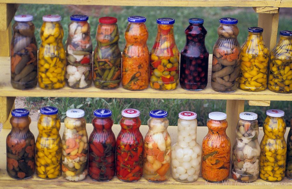 North America, Mexico, Baja California, Ensenada.  Pickled condiments for sale along the roadside in Baja California.