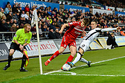 Paddy McNair (17) of Middlesbrough battles for possession with Ben Wilmot (20) of Swansea City during the EFL Sky Bet Championship match between Swansea City and Middlesbrough at the Liberty Stadium, Swansea, Wales on 14 December 2019.