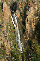 Cascade Creek feeds Crystal Falls which plummets 129 feet over this cliff face in Yellowstone National Park, Wyoming