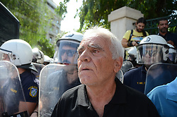 October 3, 2016 - Athens, Greece - Demonstrators shout angrily towards riot policemen after the tear gass attack..Greek pensioners demonstrate in Athens against the goverment cuts on pensions and their benefits in General. Demonstrators clashed with riot policve after they found the road to Prime Ministers office closed by police. (Credit Image: © George Panagakis/Pacific Press via ZUMA Wire)