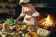 Virginia, Colonial Williamsburg, woman preparing.