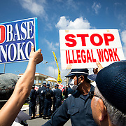 OKINAWA, JAPAN - JUNE 17 : Anti U.S. Base relocation protesters stage a rally outside the Camp Schwab on June 17, 2016 in Nago, Okinawa, Japan. Protests have grown more intense in the past days due to the past incident of rape of a Japanese woman and drunk driving in Okinawa over American military presence in Japan. Photo: Richard A. de Guzman