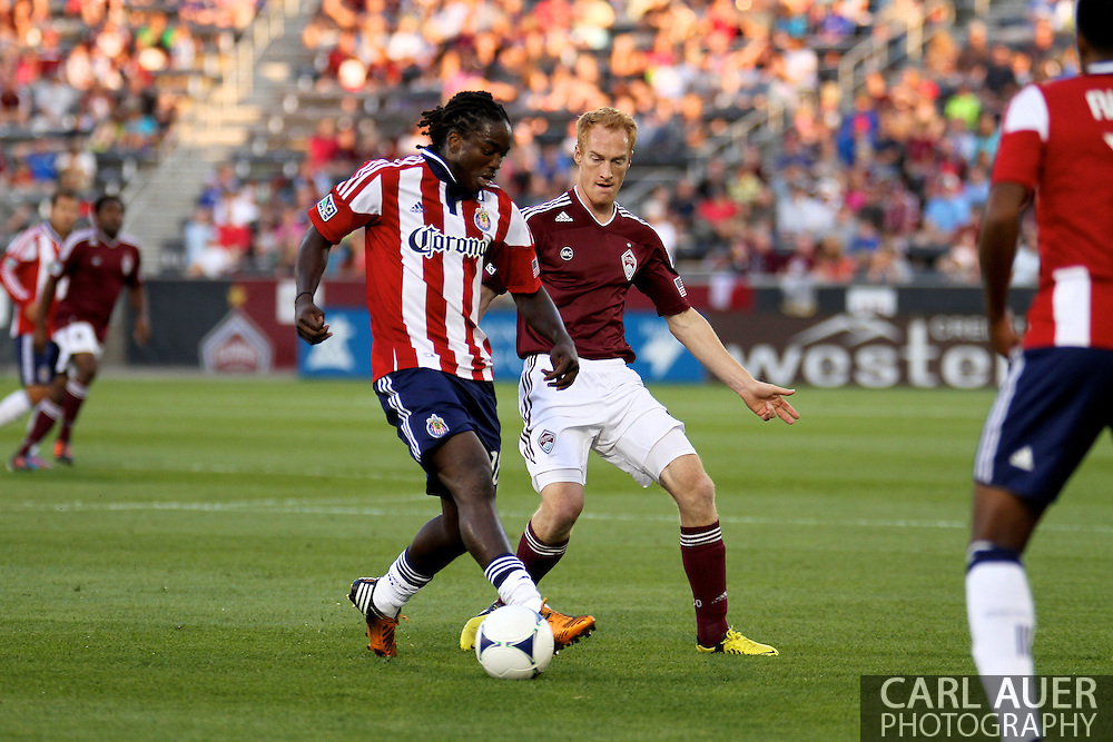 August 18th, 2012: Chivas USA midfielder Shalrie Joseph (18) tries to get free from Colorado Rapids midfielder Jeff Larentowicz (4) in the first half at Dick's Sporting Goods Park