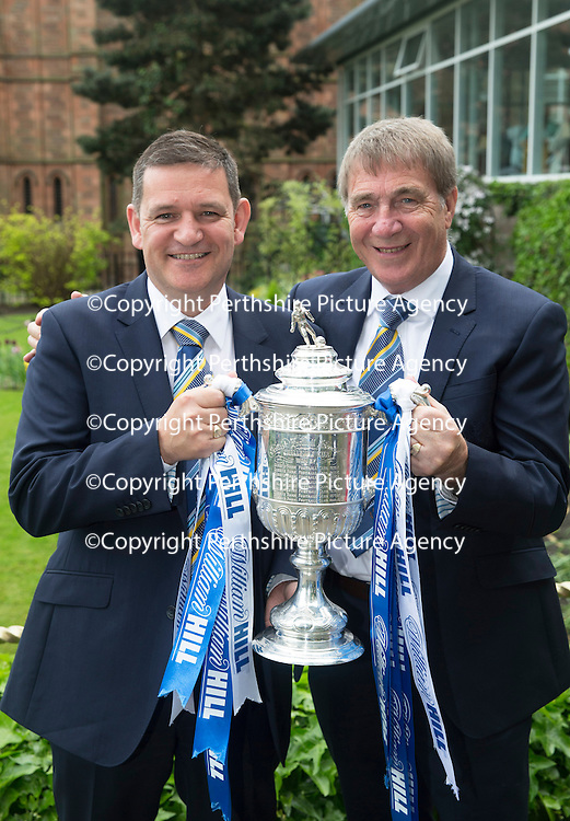 Open top bus parade by William Hill Scottish Cup Winners St Johnstone FC through the streets of Perth...18.05.14<br /> Chairman Steve Brown and his father Geoff with the Scottish Cup<br /> Picture by Graeme Hart.<br /> Copyright Perthshire Picture Agency<br /> Tel: 01738 623350  Mobile: 07990 594431