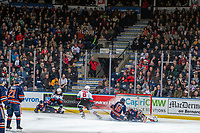 KELOWNA, BC - DECEMBER 27: Zane Franklin #16 slides into the net as Dylan Garand #31 of the Kamloops Blazers makes a second period save against the Kelowna Rockets at Prospera Place on December 27, 2019 in Kelowna, Canada. (Photo by Marissa Baecker/Shoot the Breeze)