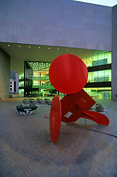 Stock photo of the sculpture Geometric Mouse X by Claes Thure Oldenburg in front of the Houston public library in downtown Houston Texas