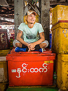 27 OCTOBER 2015 - YANGON, MYANMAR: A laborer in the fish market at Aungmingalar Jetty in Yangon. The market is home to one of the largest fish markets in Yangon and a meat and produce market.    PHOTO BY JACK KURTZ