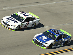 October 14, 2018 - Talladega, AL, U.S. - TALLADEGA, AL - OCTOBER 14: Alex Bowman, Hendrick Motorsports, Chevrolet Camaro LLumar (88) and Brad Keselowski, Team Penske, Ford Fusion Miller Lite (2) race side by side during the 1000Bulbs.com 500 on October 14, 2018, at Talladega Superspeedway in Tallageda, AL.(Photo by Jeffrey Vest/Icon Sportswire) (Credit Image: © Jeffrey Vest/Icon SMI via ZUMA Press)