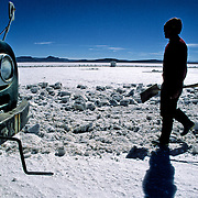 After three days of work Inocencio  Flores will have cut up to thousand blocks of salt that was going even colchani in his(her,your) truck.  Salar de Uyuni ( Uyuni salt flat ) . Department  of Potos&iacute;  ( Los Lipez).  South West  Bolivia. <br /> Adult Altiplano America Andes Arid  Aridity Axe Barren  Bicycle Block  Bolivia Cleaver Color Colour Cone  Day Daytime  Department  Desert Desolate Desolation Dry  Exterior Extraction  Geography Hack Hard Hatchet  Heat Highlands  Horizon Horizontal Human  Latin America Lake  Los Lipez Lorry  Male Man Men Miner Mining Nature  Resource  Natural  One Outdoors Outside  Pan People  Person Pyramide Potos&iacute;  Production  Region Resource Rural Salar de Uyuni  Salt Flat  Salt Pan  Salt lake  Scenic Seasoning Shovel Single Shape South America  Southwest  Sud Sunglasses  Surface Travel  Truck West White Work  Worker Working