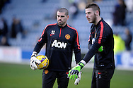 Goalkeeper Victor Valdes of Manchester United doing pre match warm up before k/o with David De Gea of Manchester United. Barclays Premier league match, Queens Park Rangers v Manchester Utd at Loftus Road in London on Saturday 17th Jan 2015. pic by John Patrick Fletcher, Andrew Orchard sports photography.