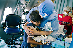 Staff nurse Ann Marie Ablett hugs patient Ruby Kahtun onboard the ORBIS DC-10 Aircraft, during the plane's visit to Kolkata, India.