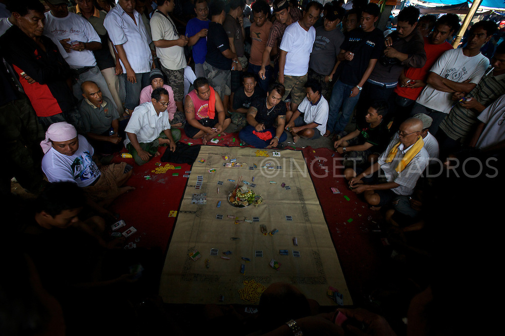 Large groups of men gambling and playing dice games.<br />