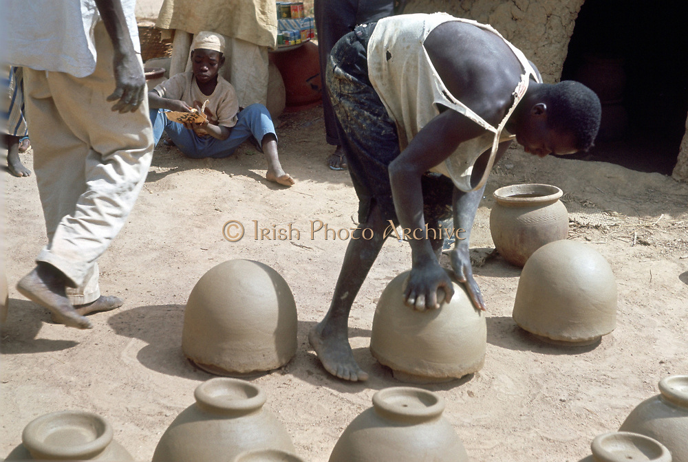 Making pots without a wheel. Nigeria c1966. Landscape format