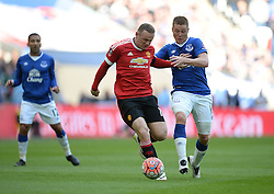 Wayne Rooney of Manchester United Battles for the ball with James McCarthy of Everton - Mandatory by-line: Alex James/JMP - 23/04/2016 - FOOTBALL - Wembley Stadium - London, England - Everton v Manchester United - The Emirates FA Cup Semi-Final