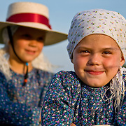 Medium closeups of two Mennonite sisters