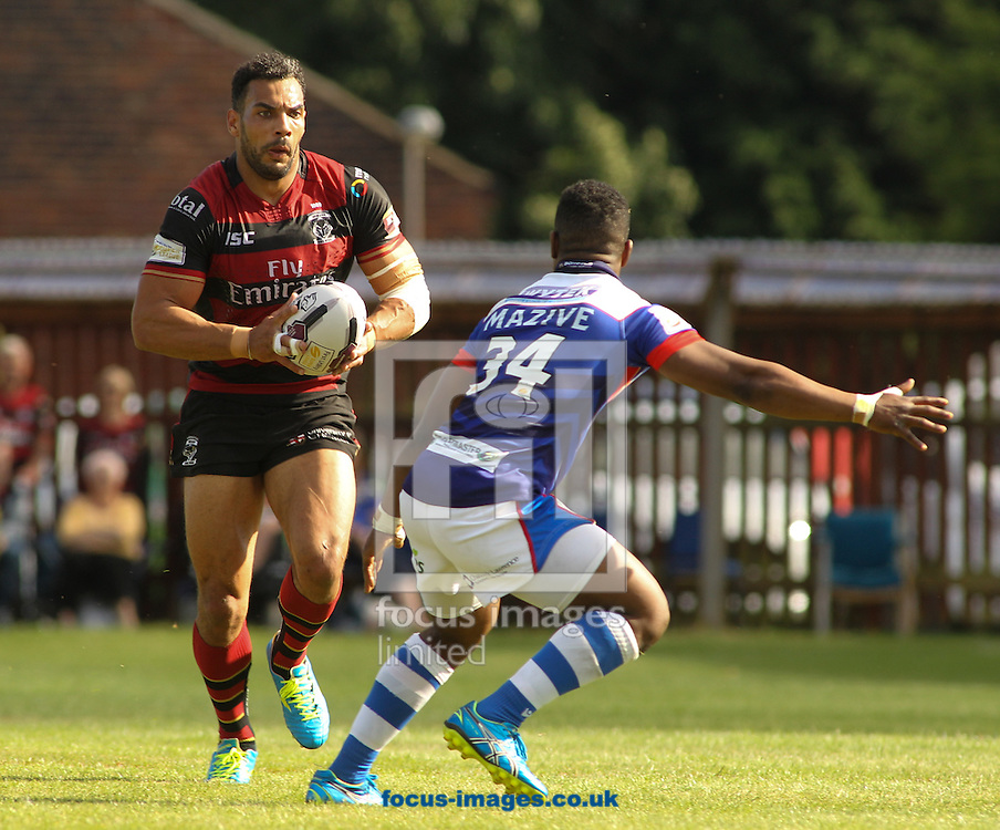 Judah Mazive (R) of Wakefield Trinity Wildcats tackles Ryan Atkins (L) of Warrington Wolves during the Super 8s match at Belle Vue, Wakefield<br /> Picture by Stephen Gaunt/Focus Images Ltd +447904 833202<br /> 14/08/2016