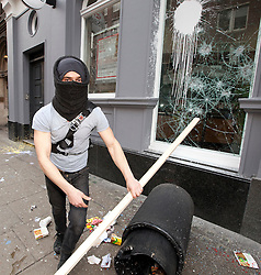 "© under license to London News Pictures. 25/03/2011: A masked protester attacking HSBC on Shaftsbury Avenue during a day of protests across London. The Home Secretary, Theresa May, is looking at giving police extra powers to force protesters to remove face coverings. Credit should read ""Joel Goodman/London News Pictures""."
