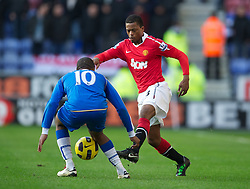 WIGAN, ENGLAND - Saturday, February 26, 2011: Manchester United's Patrice Evra in action against Wigan Athletic during the Premiership match at the DW Stadium. (Photo by David Rawcliffe/Propaganda)