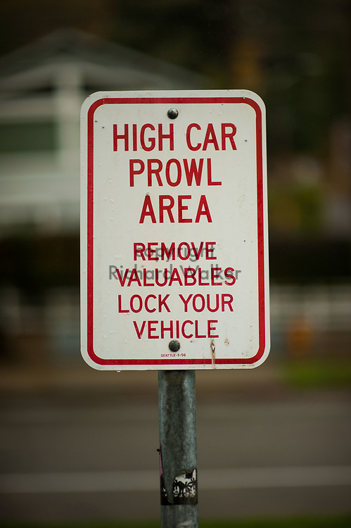 2017 NOVEMBER 20 - Car prowl warning sign at Lincoln Park in West Seattle, WA, USA. By Richard Walker