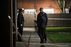 © Licensed to London News Pictures. 20/03/2019. London, UK. Police officers at the scene on Knights Close Hackney, east London where a A 28-year-old man was shot by armed police after reportedly making threats to kill while armed with knives. Photo credit: Ben Cawthra/LNP