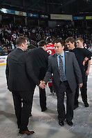 KELOWNA, CANADA - APRIL 25: Dan Lambert, assistant coach of the # of the Kelowna Rockets shakes hands with Kyle Gustafson, assistant coach of the Portland Winterhawks on April 25, 2014 during Game 5 of the third round of WHL Playoffs at Prospera Place in Kelowna, British Columbia, Canada. The Portland Winterhawks won 7 - 3 and took the Western Conference Championship for the fourth year in a row earning them a place in the WHL final.  (Photo by Marissa Baecker/Getty Images)  *** Local Caption *** Dan Lambert; Kyle Gustafson;