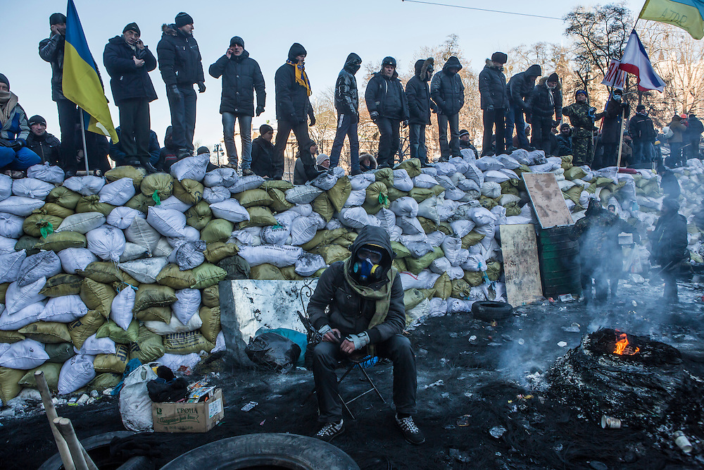 KIEV, UKRAINE - JANUARY 24: Anti-government protesters guard a barricade on a street near Dynamo stadium on January 24, 2014 in Kiev, Ukraine. After two months of primarily peaceful anti-government protests in the city center, new laws meant to end the protest movement have sparked violent clashes in recent days. (Photo by Brendan Hoffman/Getty Images) *** Local Caption ***