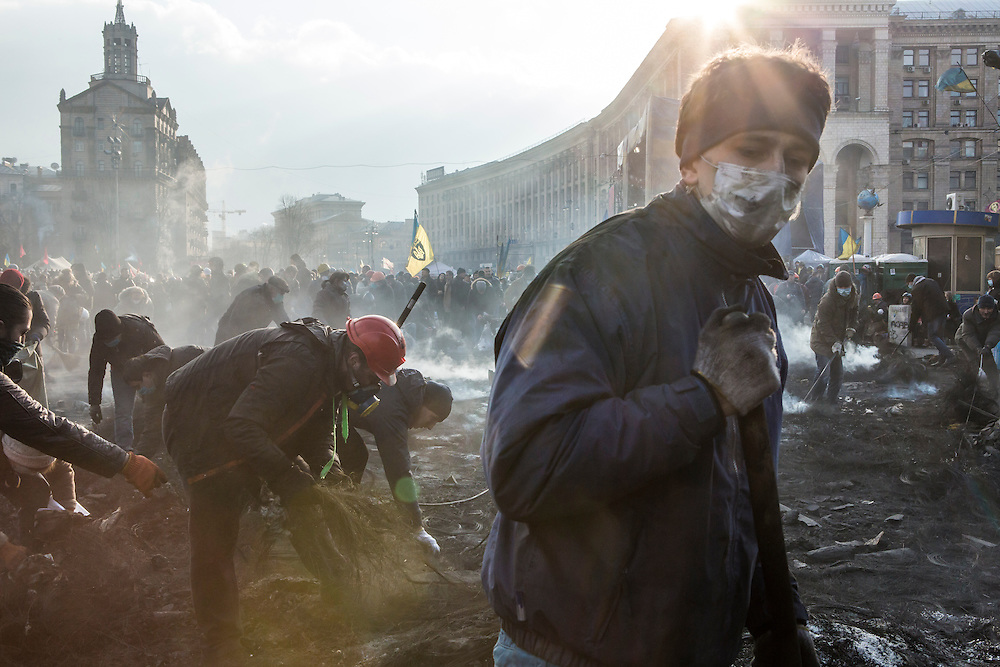 KIEV, UKRAINE - FEBRUARY 20: Anti-governent protesters clear ashes and debris from a newly occupied portion of Independence Square on February 20, 2014 in Kiev, Ukraine. After several weeks of calm, violence has again flared between anti-government protesters and police, with dozens killed. (Photo by Brendan Hoffman/Getty Images) *** Local Caption ***