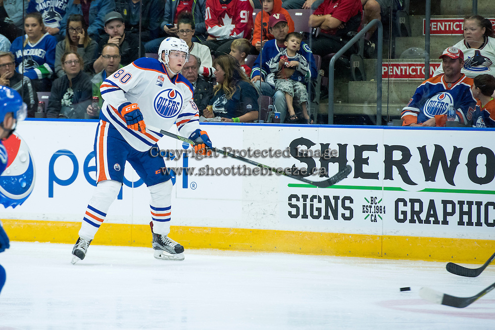 PENTICTON, CANADA - SEPTEMBER 16: Markus Niemelainen #80 of Edmonton Oilers cases the puck against the Edmonton Oilers on September 16, 2016 at the South Okanagan Event Centre in Penticton, British Columbia, Canada.  (Photo by Marissa Baecker/Shoot the Breeze)  *** Local Caption *** Markus Niemelainen;