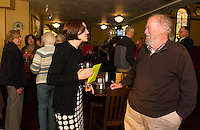 Laconia Planning Director Shanna Saunders is wished well by Warren Clement during a reception in her honor at the Holy Grail on Tuesday evening.  (Karen Bobotas/for the Laconia Daily Sun)