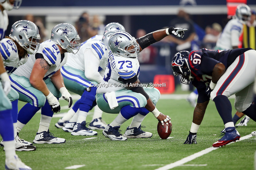 Dallas Cowboys guard Mackenzy Bernadeau (73) points at the Houston Texans defensive line as the offensive line gets set at the line of scrimmage during the 2015 NFL preseason football game against the Houston Texans on Thursday, Sept. 3, 2015 in Arlington, Texas. The Cowboys won the game 21-14. (©Paul Anthony Spinelli)